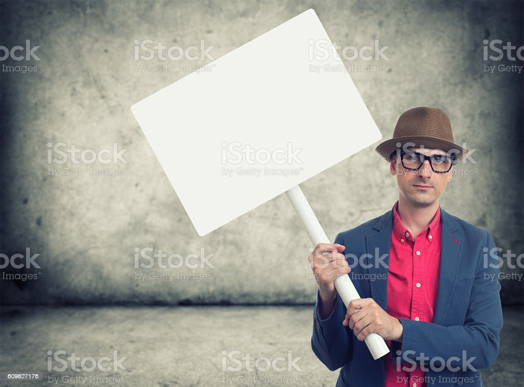 trendy man holding protest sign stock photo