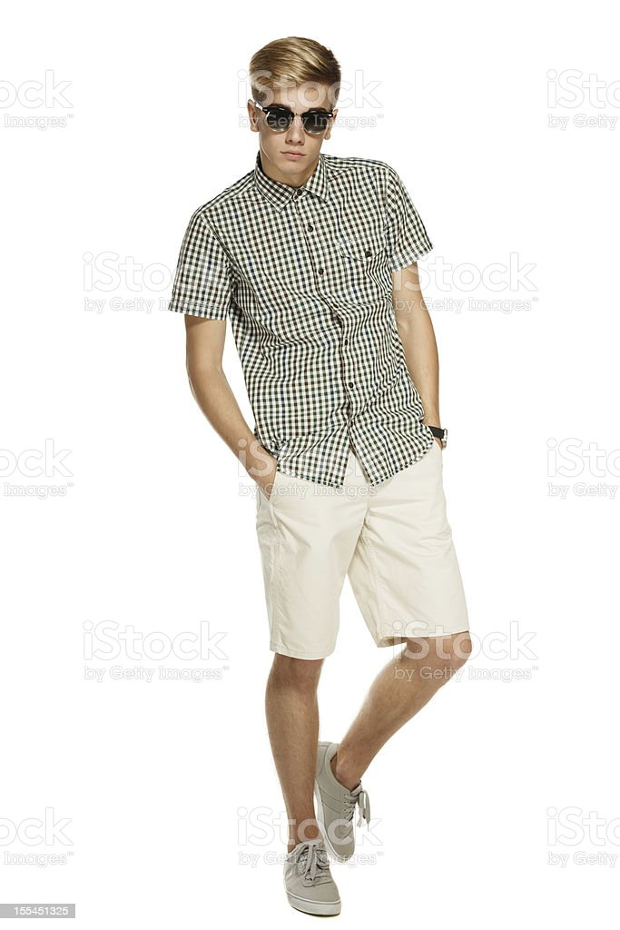 Trendy man in shorts and sunglasses stock photo
