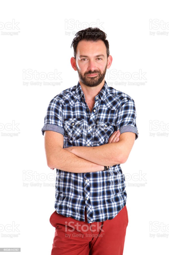 Trendy mature man standing with arms crossed over white background stock photo