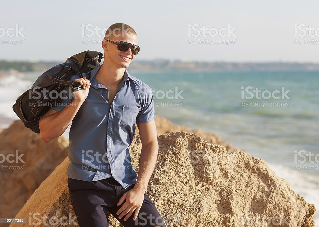 Trendy perfect body guy posing on the beach royalty-free stock photo