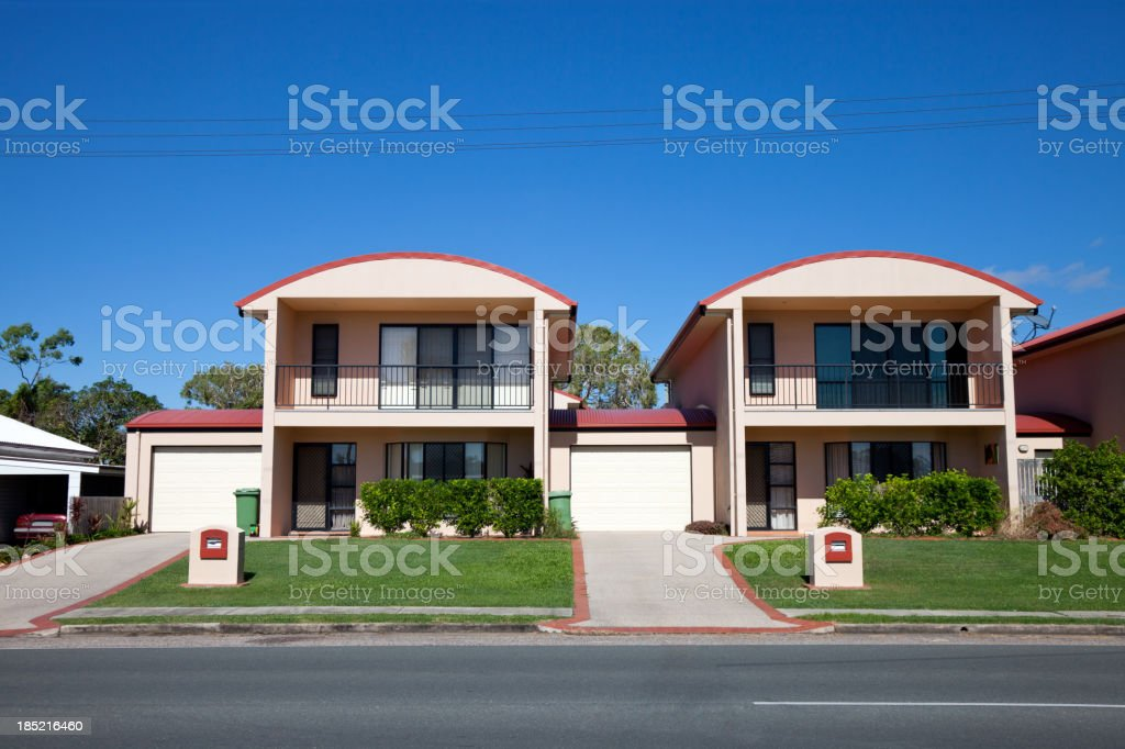 Trendy Urban Townhouses with blue sky royalty-free stock photo