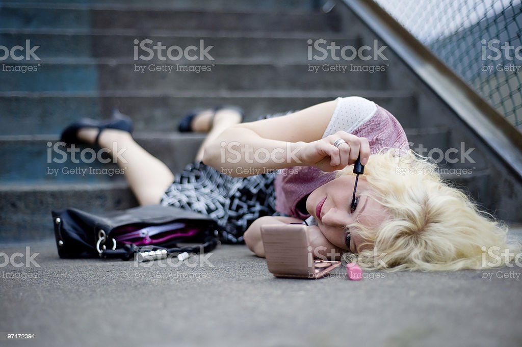 Trendy Woman Putting on Makeup royalty-free stock photo