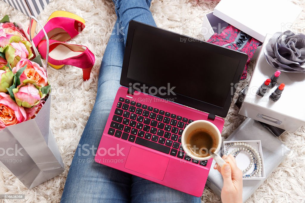 Trendy woman relaxing at home stock photo