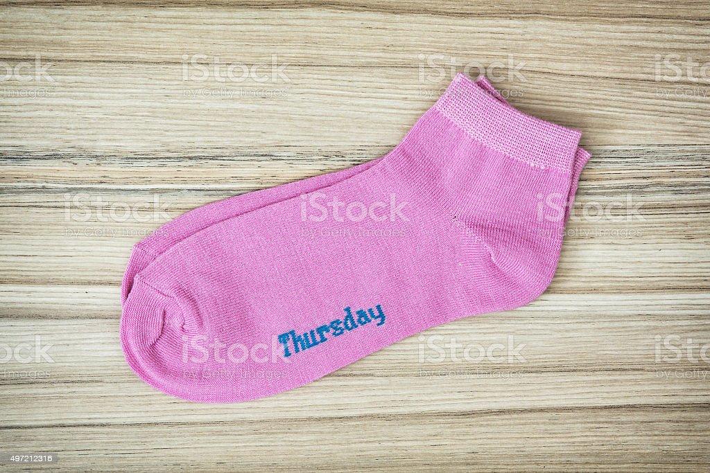 Trendy wool socks with inscription THURSDAY stock photo