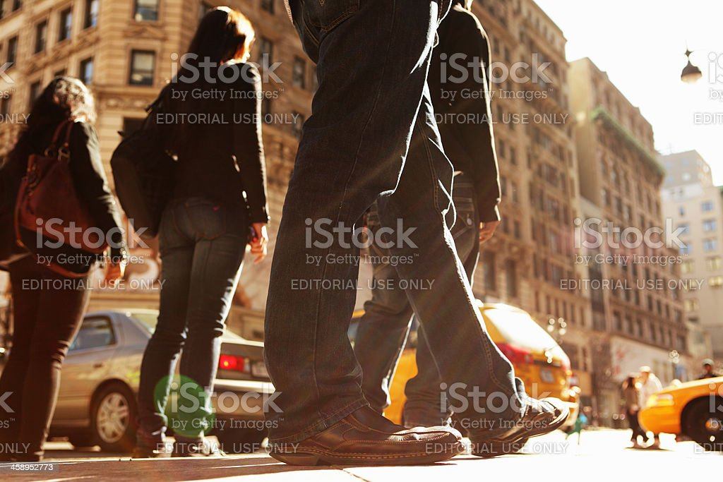 NYC Trendy young man waits to cross 5th Avenue royalty-free stock photo
