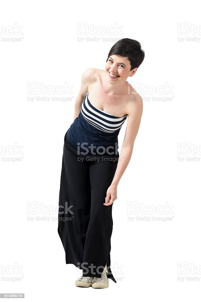Trendy young woman in wide-leg pants leaning and laughing stock photo