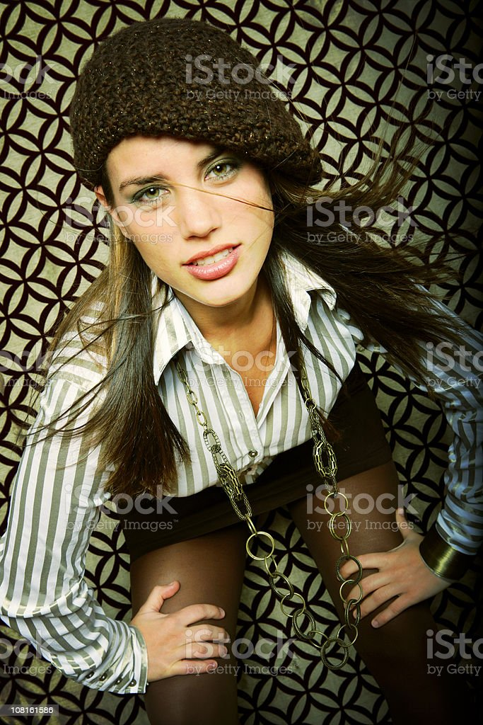 Trendy Young Woman Posing Against Modern Background royalty-free stock photo