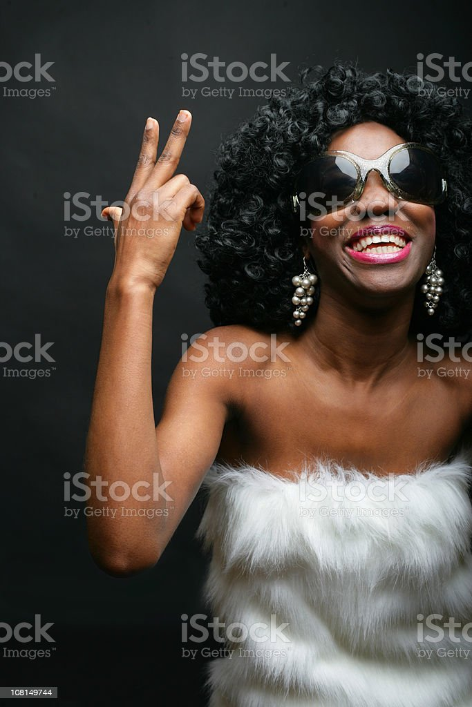 Trendy Young Woman Posing and Smiling on Black Background royalty-free stock photo