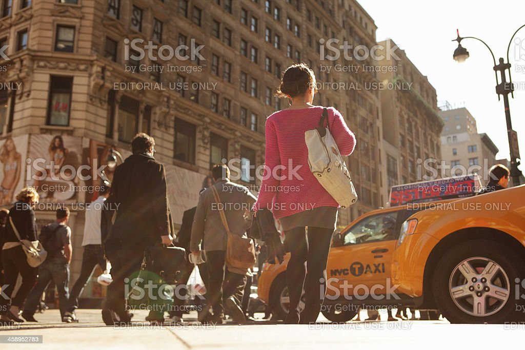 NYC Trendy young woman waits to cross 5th Avenue royalty-free stock photo