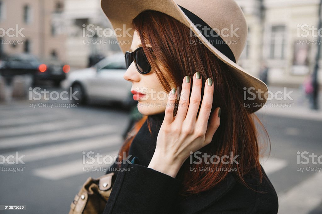 Trendy young woman wearing wool hat stock photo