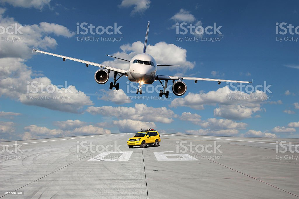 Treshold of runway with car and plane stock photo