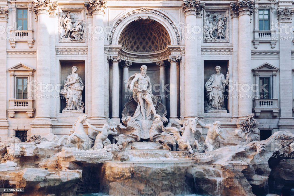 Trevi fountain at sunrise, Rome, Italy. Rome baroque architecture and landmark. Rome Trevi fountain is one of the main attractions of Rome and Italy stock photo