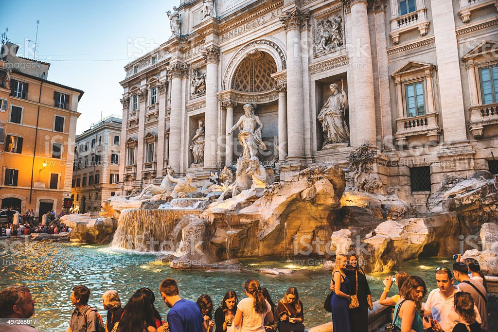 Trevi fountain in Rome full of tourist stock photo