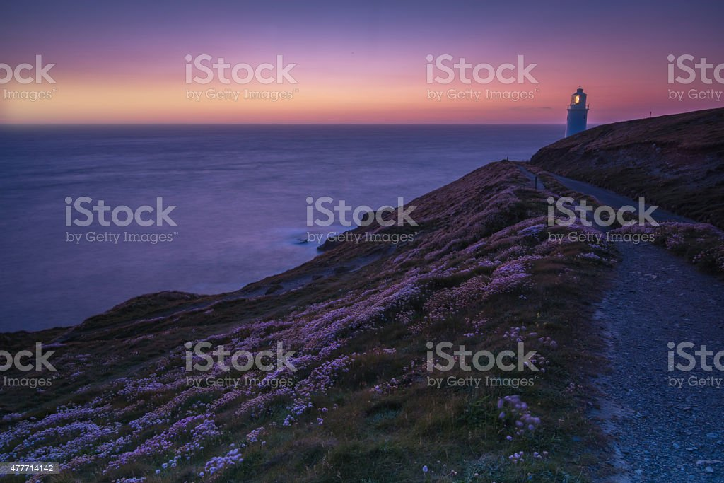 Trevose Head lighthouse on rocky cliffs in Cornwall, England stock photo