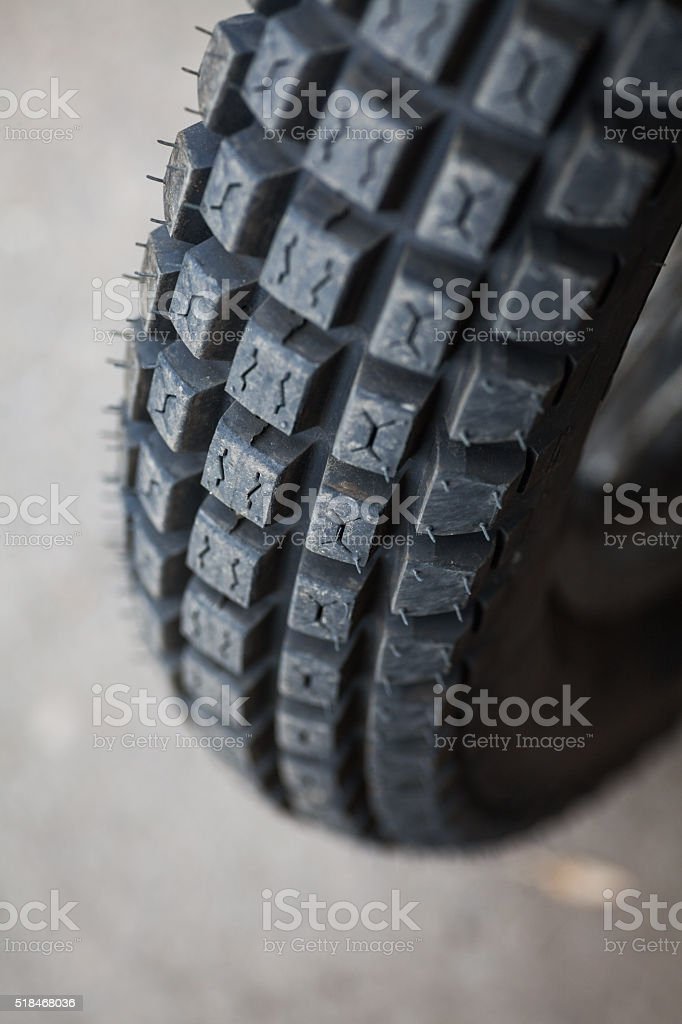Trial motorcycle knobby tire stock photo