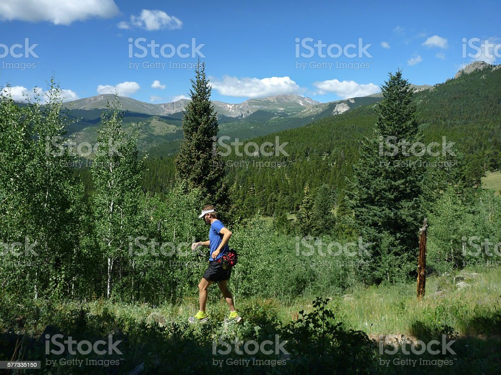 Trial running young man Mount Evans Wilderness Colorado Rocky Mountains stock photo