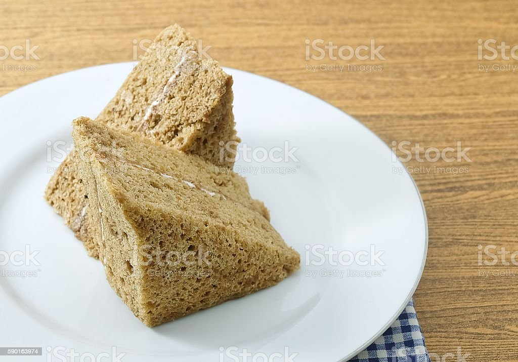 Triangle Coffee Chiffon Cake on A White Dish stock photo