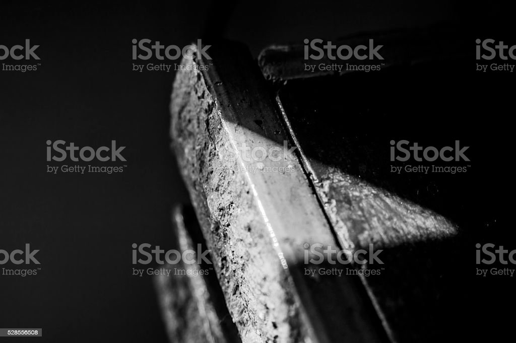 triangle of light on the darkness stock photo