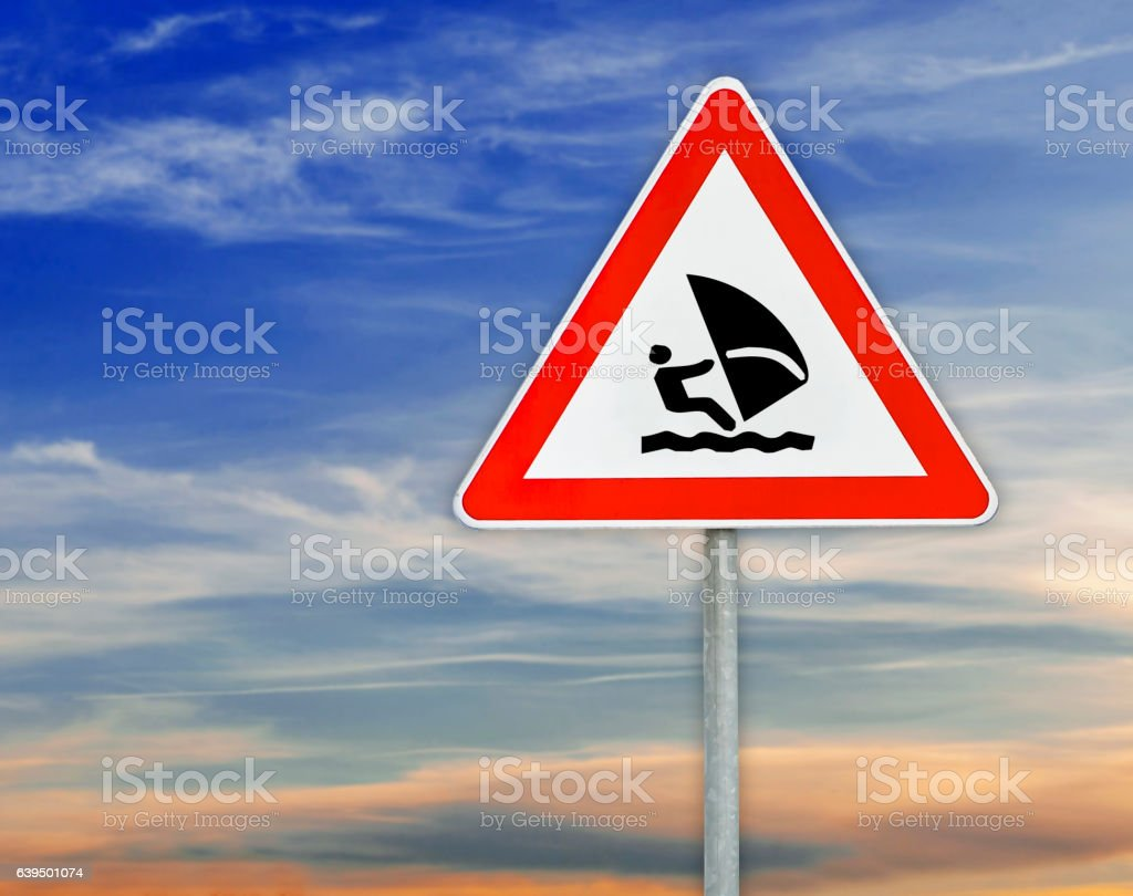 Triangle on rod road sign boat sailing with cloudy sky stock photo