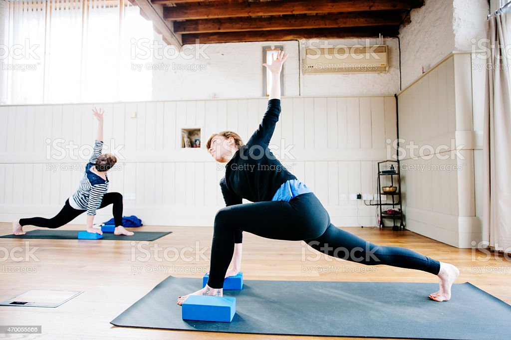 Triangle position, Utthita Trikonasana, Yoga class, exercise studio stock photo