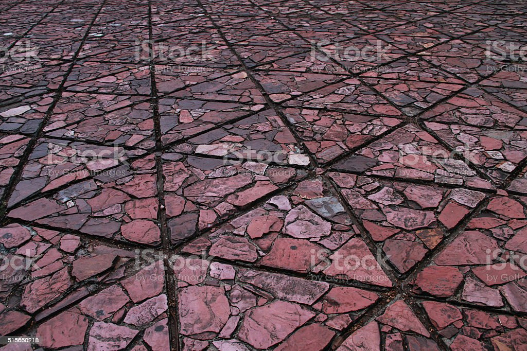 Triangle shape ground block has texture part of flat stone. stock photo