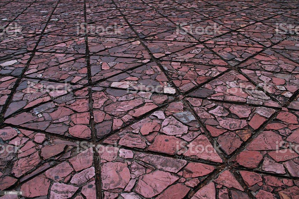 Triangle shape ground block has texture part of flat stone. stock photo