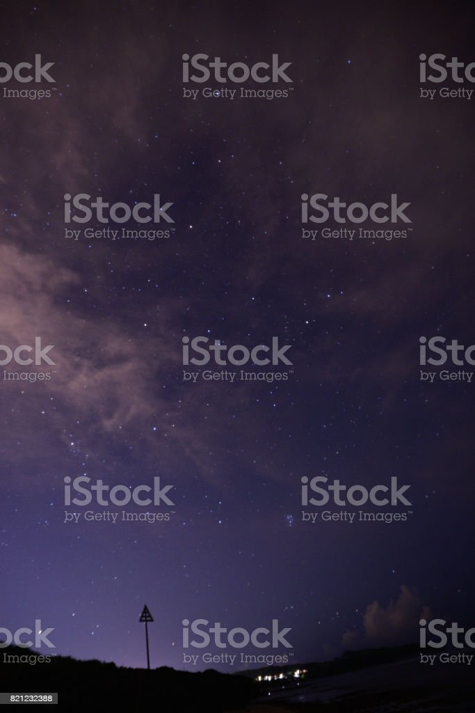 Triangle sign and starry sky stock photo