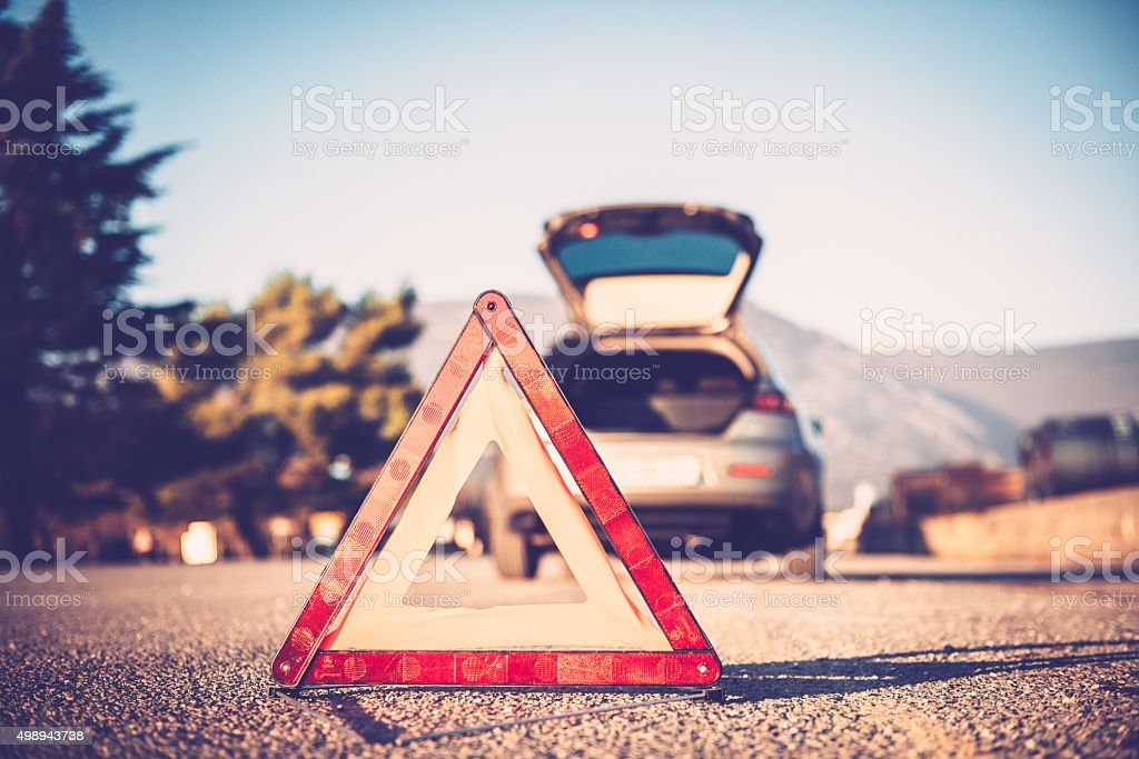Triangle Warning Sign on a Road stock photo