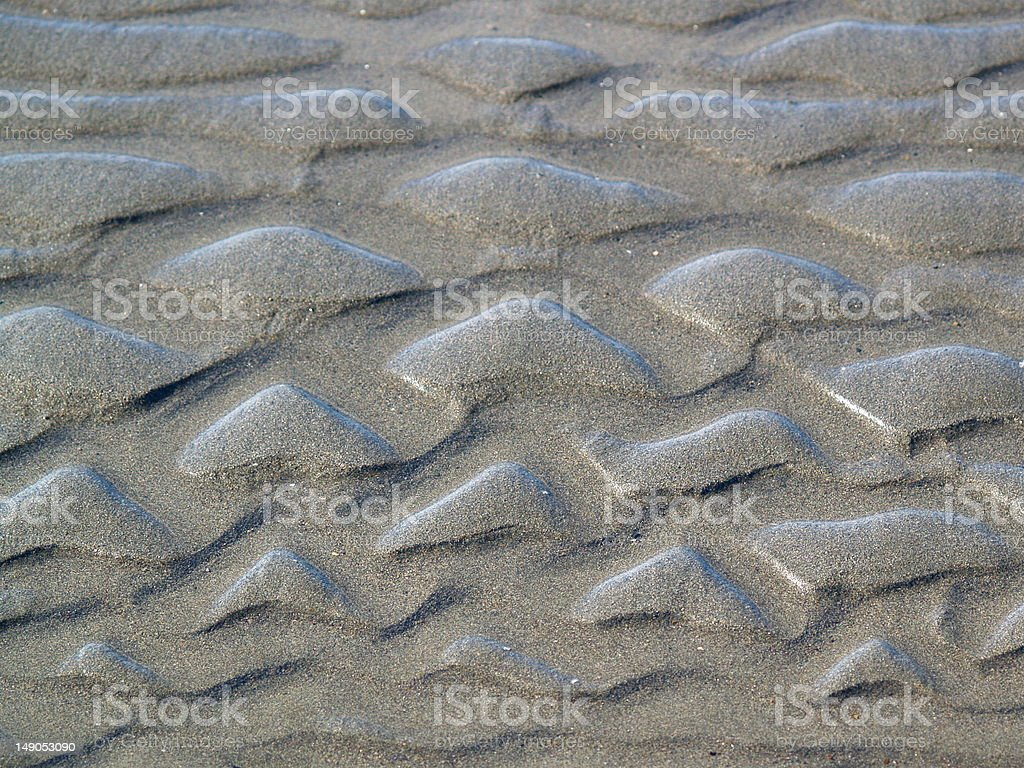 Triangles in the sand. stock photo