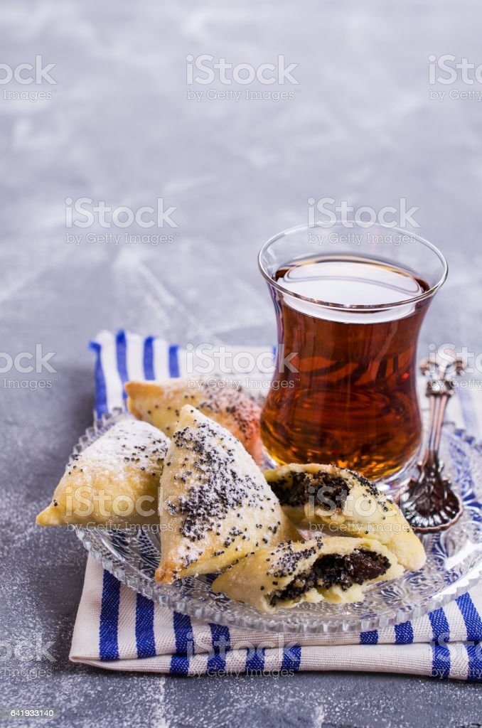 Triangular cookies with poppy seeds stock photo