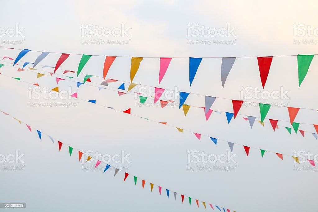 Triangular Flags Hanging in the Sky at an Outdoor stock photo
