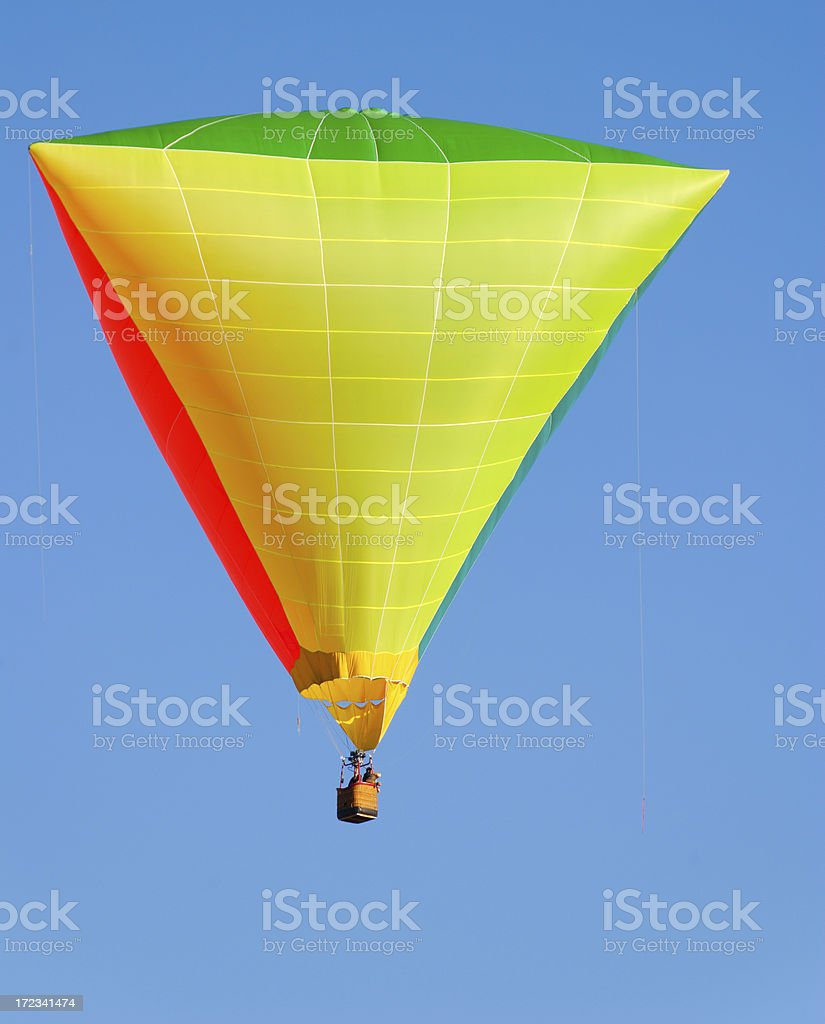 Triangular Hot Air Balloon on a Clear Blue Sky royalty-free stock photo