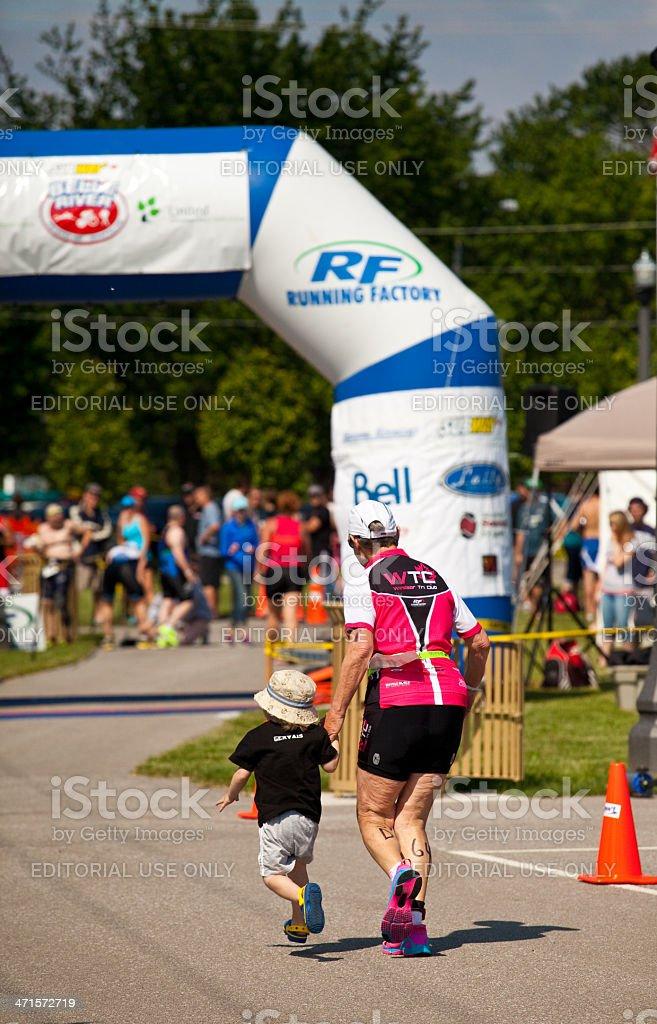 Triathlete Approching Finishline stock photo