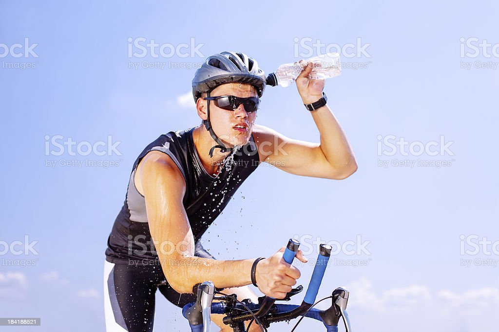 Triathlete cycling on a bicycle stock photo