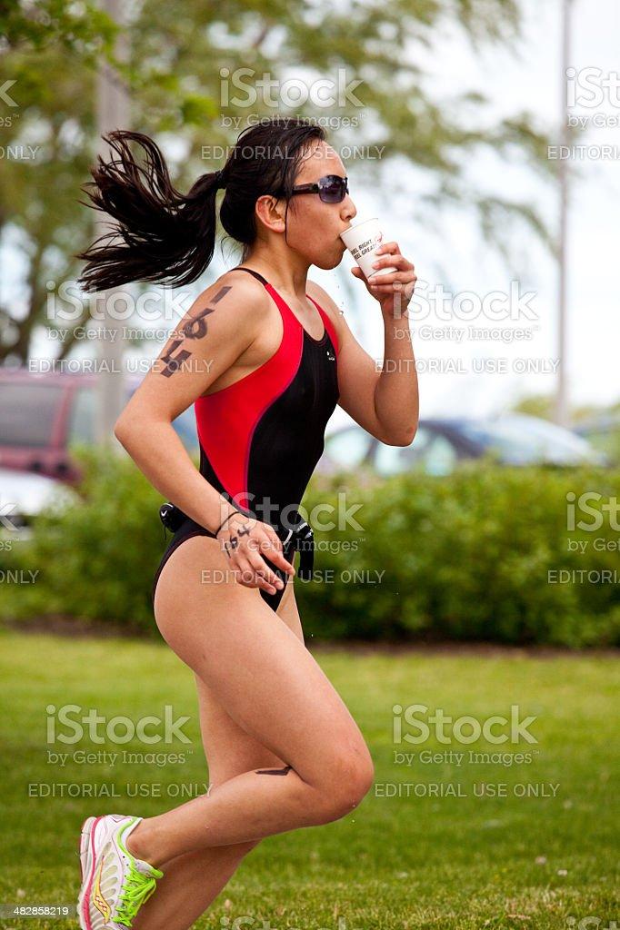 Triathlete Drinking stock photo