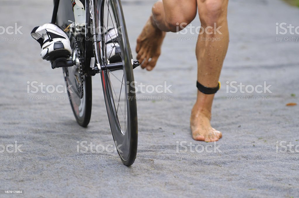 Triathlete in transition zone with timechip stock photo
