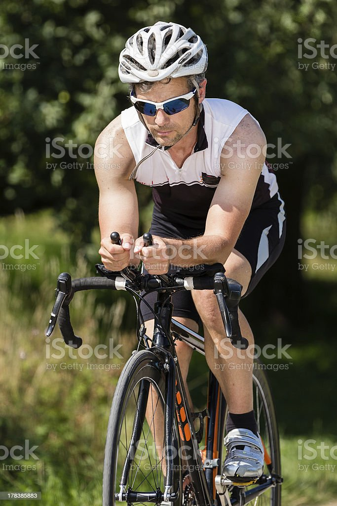 triathlete on a bicycle royalty-free stock photo