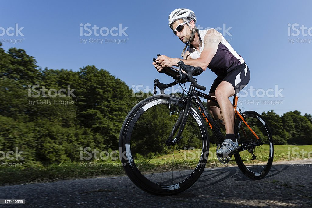 Triathlete on a bike stock photo