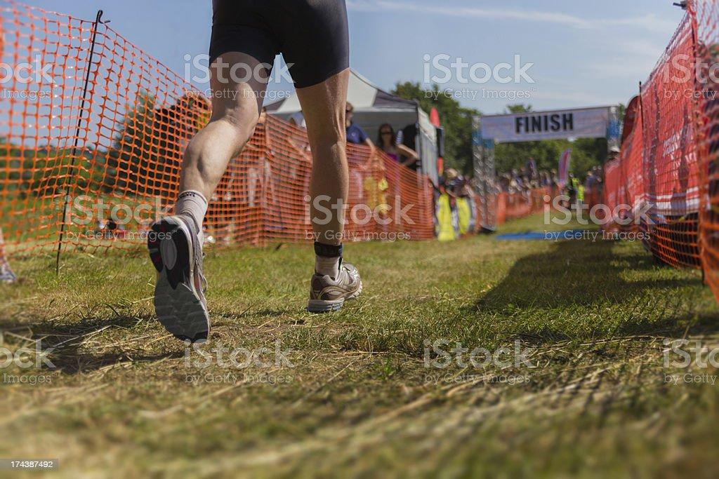 Triathlete runner finish line stock photo