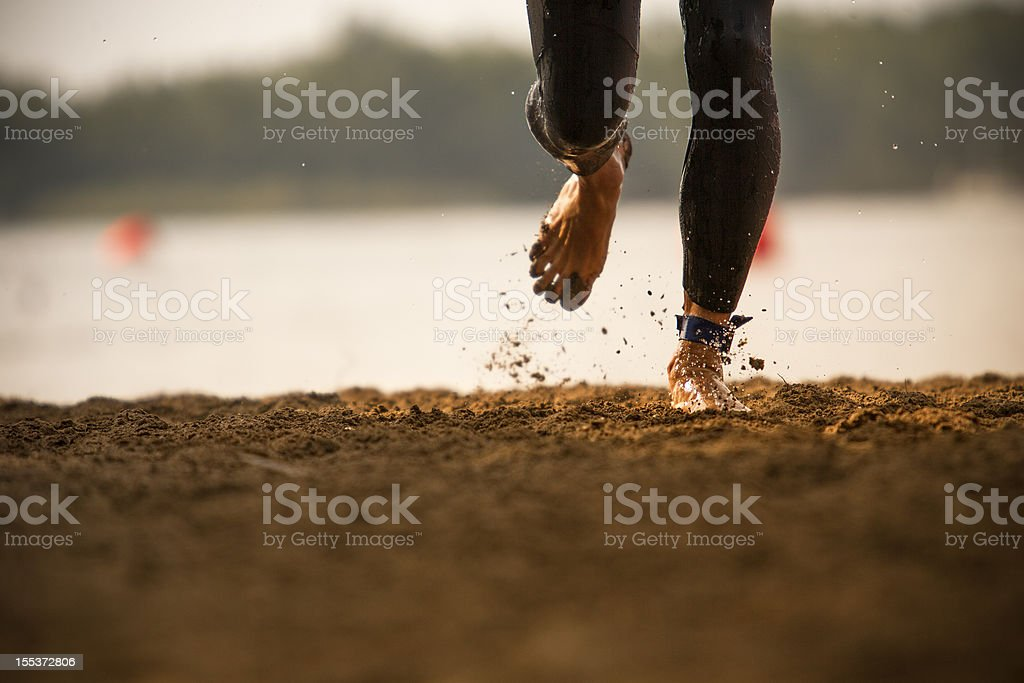Triathlete runs out of a lake royalty-free stock photo