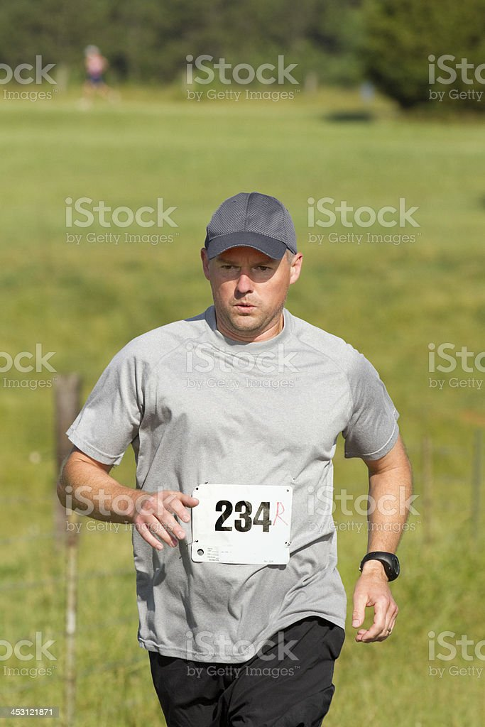 Triathlon Triathlete Running With Other Athletes Behind royalty-free stock photo