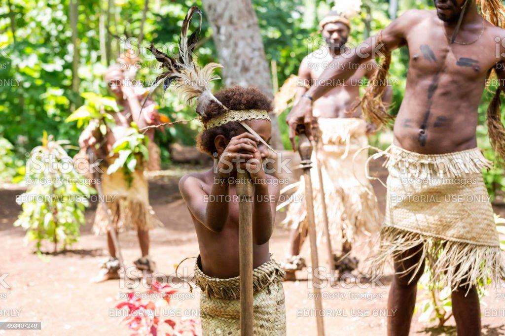 Tribal boy performing ritual dance, Vanuatu stock photo