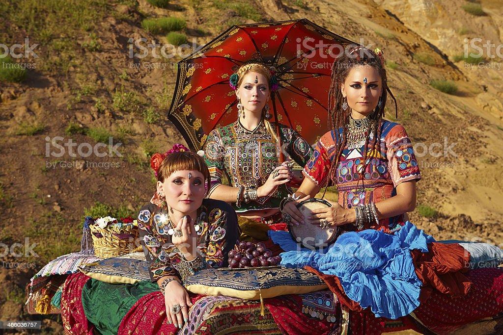 Tribal dancers. Women in ethnic costumes. stock photo