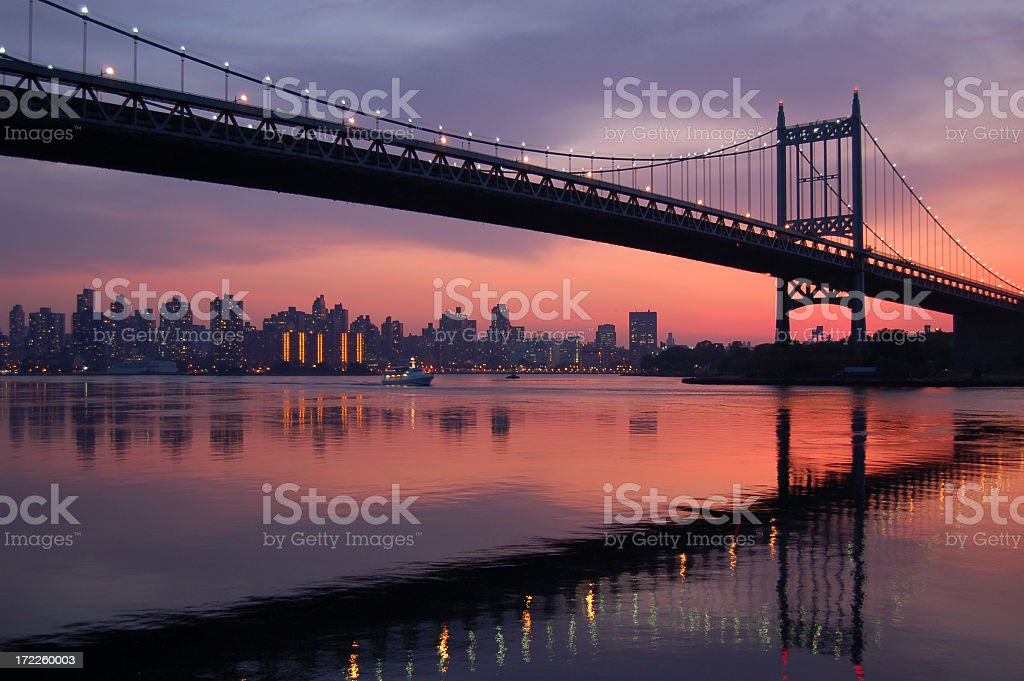 Triboro bridge silhouette at sunset stock photo