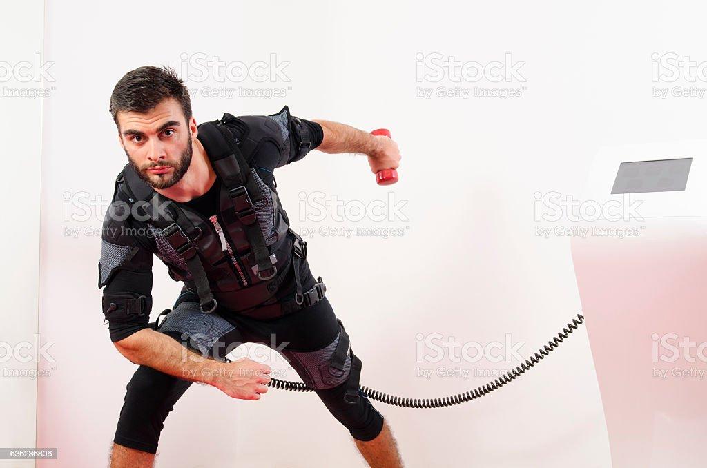 Triceps exercise on muscle stimulator stock photo