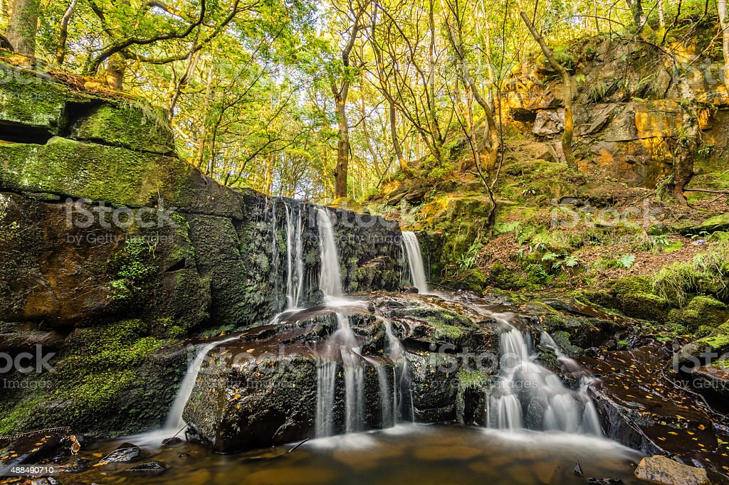 Trickling Waterfall In A Beautiful British Forest. stock photo