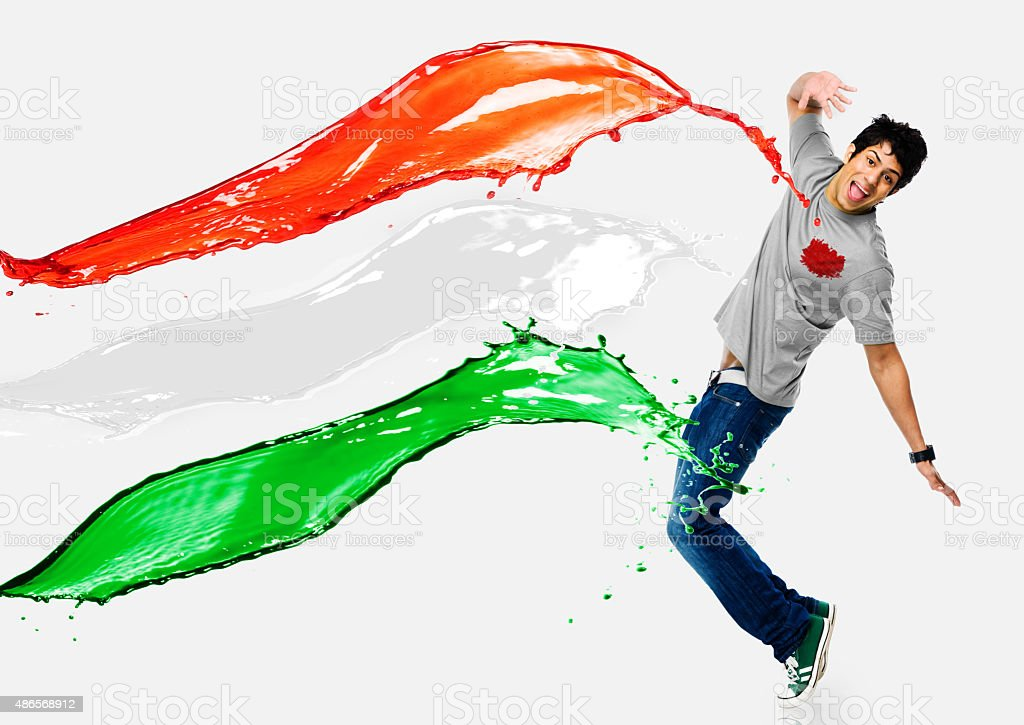 Tricolor paints being splashed on a man stock photo