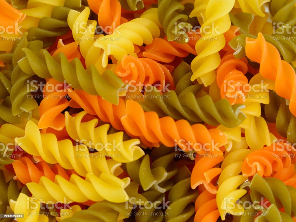 Tri-color penne pasta, filling the frame. Tomato, spinach and wheat pastas. dry Italian pasta stock photo
