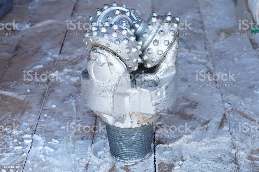 Tricone drill bit stock photo