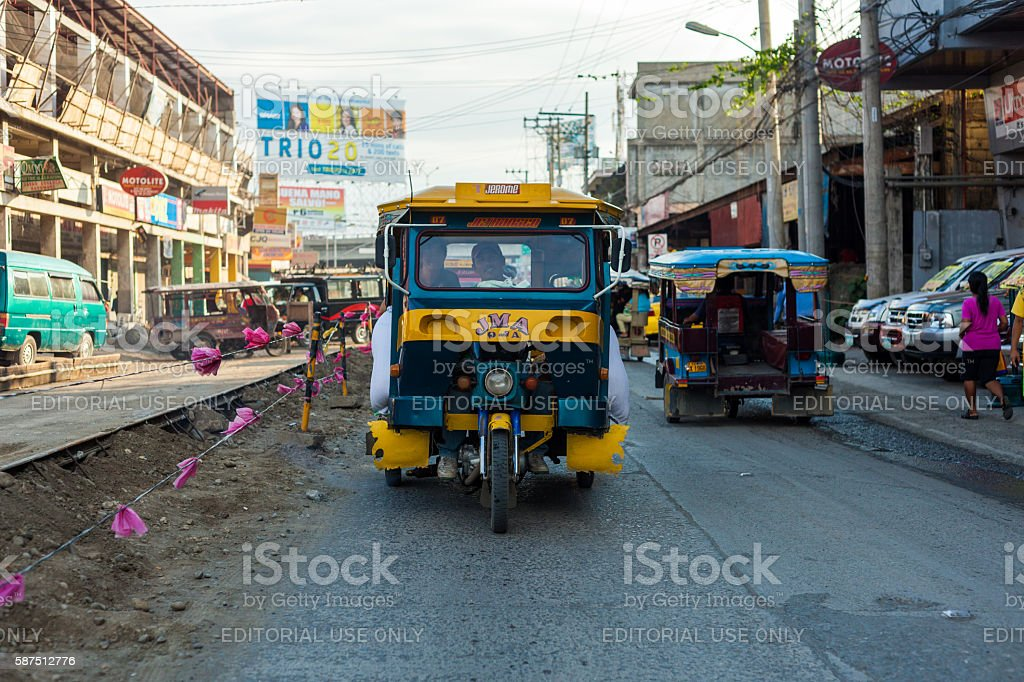 Tricycle in the streets of Davao stock photo